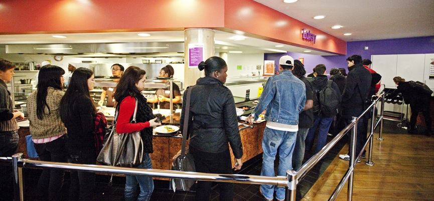 Customers waiting to be served at the Curve Restaurant counter.